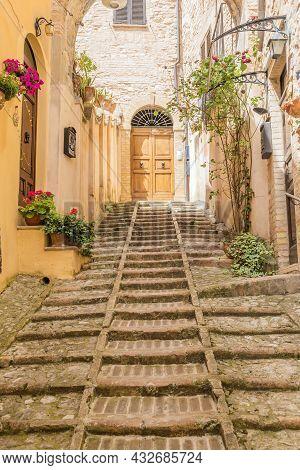 Spello, Italy - Circa June 2021: Flowers In Ancient Street. Spello Is Located In Umbria Region, Ital