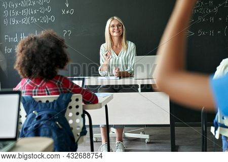 Smiling Happy Caucasian Female Teacher With Class Teaching Mathematics To Elementary Middle Diverse