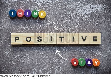 Think Positive And Stay Positive Text On The Wooden Blocks With White Arrow Lifestyle Concept.