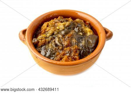 Turkish Eggplants With Tomatoes In A Terracotta Bowl On A White Background