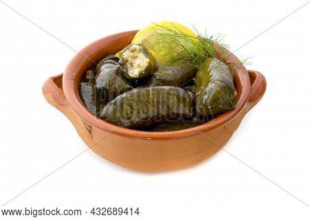 Dolmadakia Yalantzi In A Terracotta Bowl On A White Background