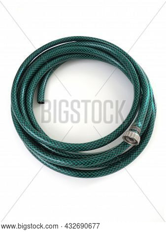 Extendable Irrigation Hose Isolated. Aerial View Of Roller Garden Hose On White Background. Gardenin