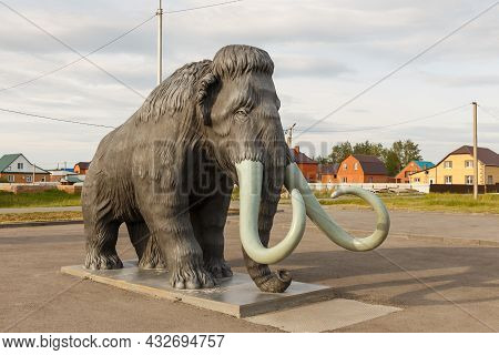 Abatskoe Village, Tyumen Region, Russia - June 12, 2021: A Statue Of A Mammoth On The Square Of The