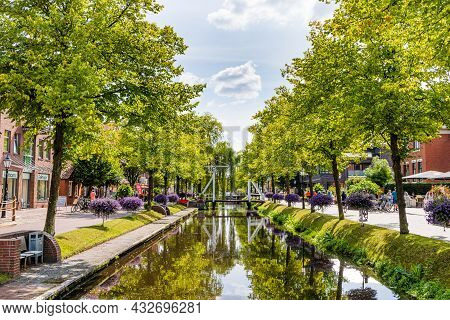 Papenburg, Germany - August 24, 2021: Colorful Old Village Centre Of Papenburg Along River Ems With