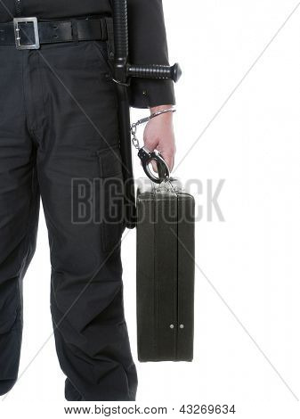 Closeup of male security guy carrying black suitcase handcuffed to his hand shot on white