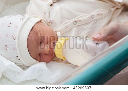 Feeding a newborn baby in maternity hospital poster