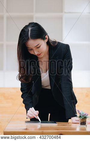 Businesswoman Using A Calculator Application On Tablet To Audit The Companys Budget. Tax Information