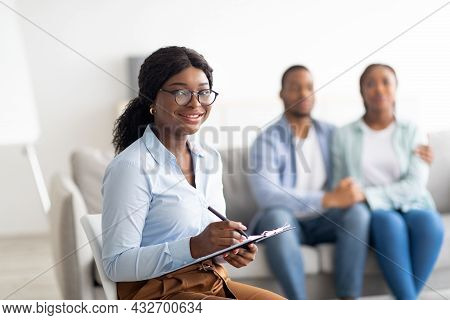 Portrait Of Black Female Marital Counselor At Office After Effective Session With Young Married Coup