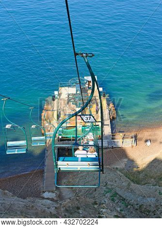 The Needles Chairlift, Isle Of Wight, 2021. A Chairlift Taking Passengers Don To The Bay Below.  Thi