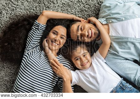 Closeup Portrait Of Happy Middle-eastern Family Cuddling On Floor