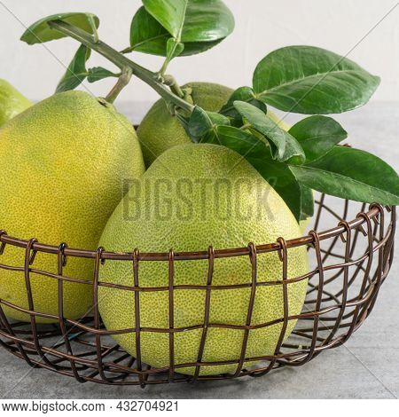 Fresh Pomelo Fruit On Gray Cement Background.