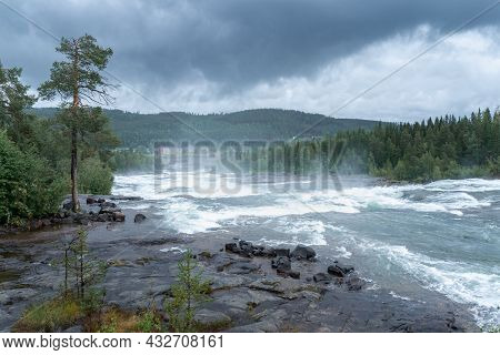 Storforsen, Wild, Huge Waterfall On Pite River In Swedish Arctic On A Cloudy, Rainy Day Of Arctic Su