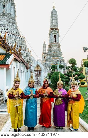 Bangkok, Thailand - January 16,2020. Beautiful Thai Women In Colorful Traditional Dress At Buddhist