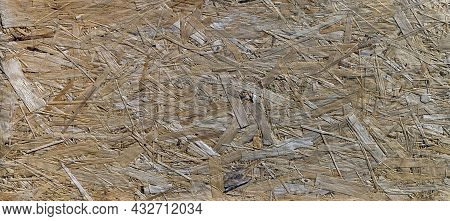 Oriented Strand Board Texture. The Wood Shavings Are Compressed And Positioned In Different Directio