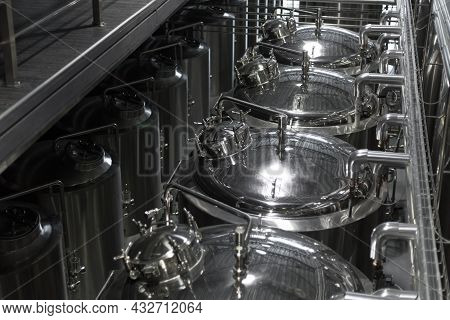 Modern Beer Factory. Steel Tanks For Beer Fermentation And Storage. Brewery. Modern Beer Plant With