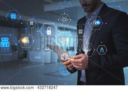 Businessman Wearing Formal Suit Is Holding A Tablet With Digital Interface With Hologram Of Globe, C