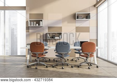 Panoramic Interior Of The Beige Meeting Room With A Brief Discussion Table, Blue And Terracotta Offi