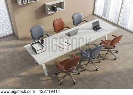 Top View Of A Conference Room With Blue And Terracotta Office Chairs, A White Wood Table, Panoramic