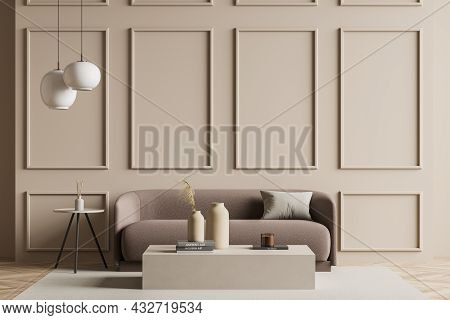 Beige Living Room Interior With A Light Brown Sofa, Two Armchairs, Coffee Tables, Pendant Lights, Wa