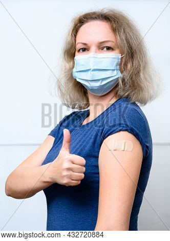 Vaccinated Young Woman Showing Shoulder With Plaster, Female Person In Mask Thumb Up After Getting C