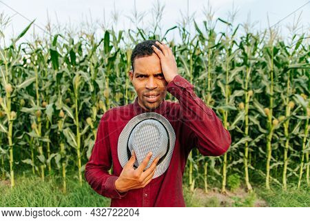 Young African American Afro Farmer Man With Hat Thinking Looking Tired And Bored With Depression Pro