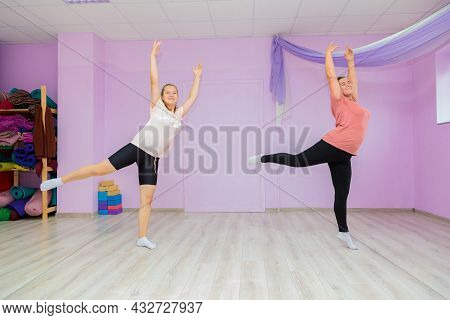 Girl Dance Instructor Shows The Elements Of The Number To Another Girl. Dance Training.