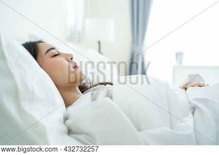 Asian Beautiful Comfort Girl In Pajamas Get Up From Sleep In Bedroom. Attractive Young Woman Lying D