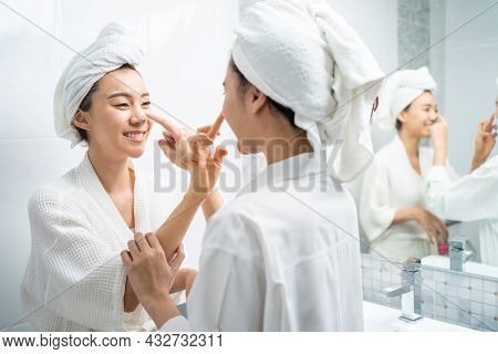 Asian Lesbian Gay Couple Putting Smooth And Skin Care For Facial Soft. Attractive Funny Woman Friend