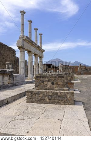 Forum Of Pompeii With The Entrance To The Basilica, Pompeii, Naples, Italy. Ruins Of An Ancient City