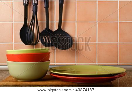 Stack Of Plates On A Background Of A Ceramic Tile