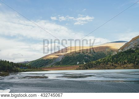 Scenic Autumn Landscape With Mountain Lake And Motley Mountains With Forest. Colorful Alpine View To