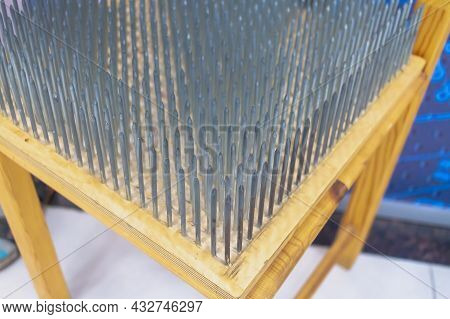 The Seat Is Made Of Sharp Nails. A Lot Of Nails Are Driven Into The Chair. The Concept Of Overcoming