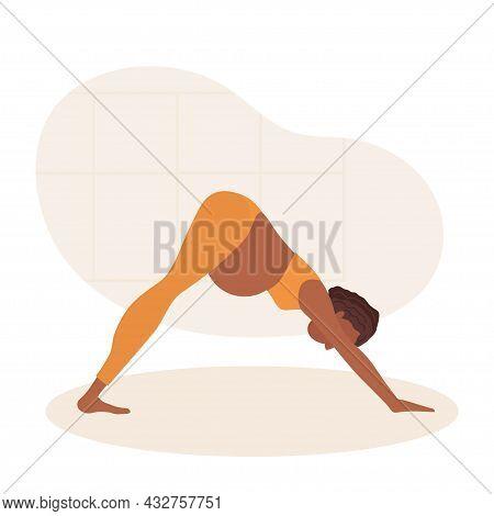 Adho Mukha Shvanasana. Pregnant African American Woman Doing Yoga. Woman In Sportswear Makes Downwar
