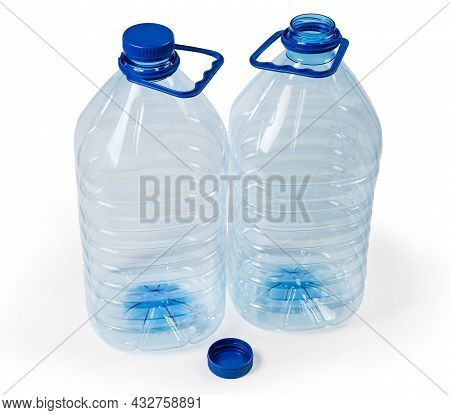 Two Empty Large Blue Transparent Plastic Bottles For Drinking Water With Screw Caps And Carrying Han