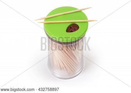 Wood Toothpicks In Special Transparent Plastic Container With Dispenser In The Cap, Top View On A Wh
