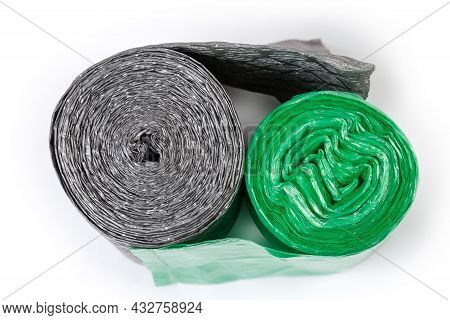 Two Rolls Of Different Green And Gray Disposable Biodegradable Garbage Bags On A White Background, T