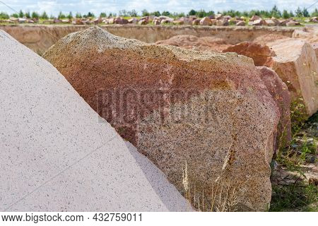 Large Blocks Of Red Granite With Flat Sides After Stone Cutting Tool Work And Torn Sides Lie On The