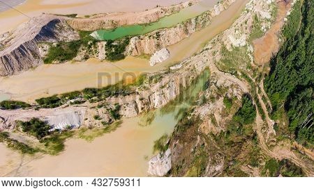 Colored Lakes Among The Old Waste Rock Dumps Arisen On The Site Of The Abandoned Ilmenite Quarry On