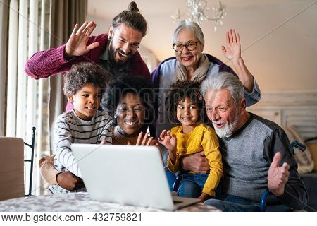 Portrait Of A Happy Multigenerational Multiethnic Family At Home.
