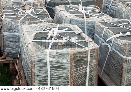 Stacked Paved Stones On Pallets Prepared For Transportation. High Quality Photo