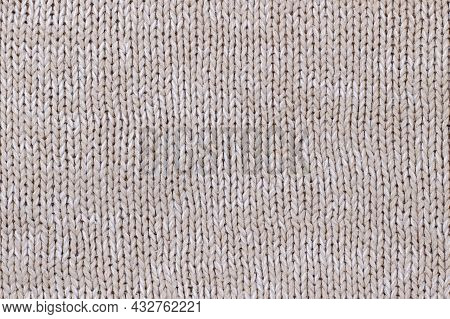 Beige Texture Of Knitted Wool Sweater. Hand Knitting. Classic Knit Stitches - The Basis Of Knitting