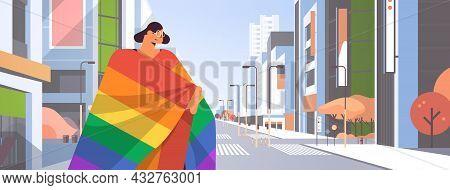 Woman With Lgbt Rainbow Flag Walking On City Street Gay Lesbian Love Parade Pride Festival Transgend