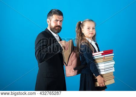 Little School Girl Hold Big Stack School Textbook Notebook Books. Father Teacher Helping To Pupil, P