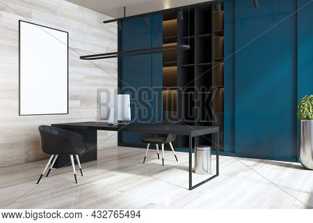 Modern Blue And Wooden Home Office Interior With Workplace, Empty White Mock Up Poster, Bookcase And