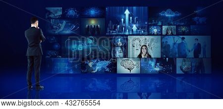 Young European Businessman Looking At Media Picture Gallery. Digital Multimedia Concept