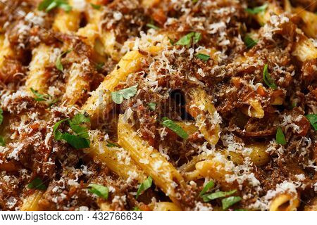 Pasta Alla Genovese On A White Bowl With Parmesan Cheese. Traditional Neapolitan Food.
