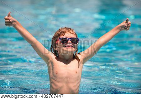 Child In Summer Swimming Pool. Activities Child On The Pool, Children Swimming And Playing In Water,