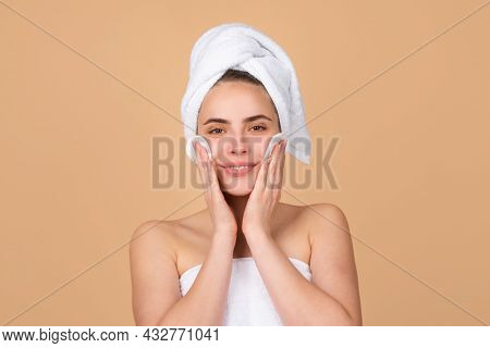 Facial Treatment. Cosmetology Beauty And Spa. Girl Apply Skincare Cream On Face, Woman Wrap Towel On