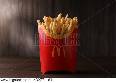 Mykolaiv, Ukraine - August 12, 2021: Big Portion Of Mcdonald's French Fries On Wooden Table