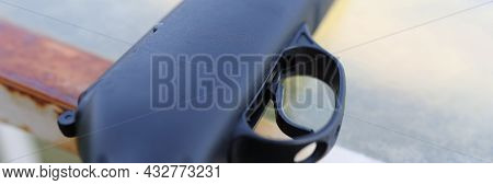 Black Firearm With Trigger Lies On Table Closeup